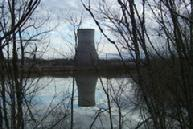 Nuclear power plant cooling tower reflection.